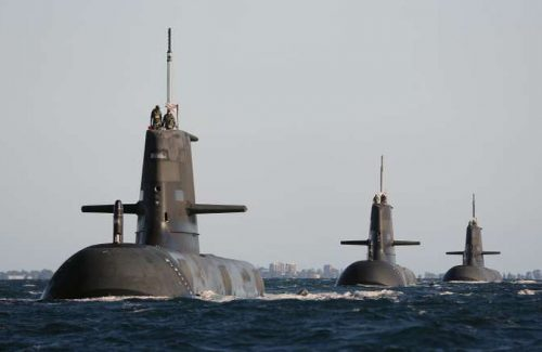 This handout photo released by the Royal Australian Navy and taken on March 22, 2015 shows Australian Collins class submarines (L to R) HMAS Dechaineux, HMAS Waller and HMAS Sheean in formation in Cockburn Sound, near Rockingham in Western Australia. Australia's next generation of submarines could be built locally, Defence Minister Kevin Andrews has hinted, reversing plans reportedly favoured by former prime minister Tony Abbott to buy the vessels directly from Japan.  France, Germany and Japan are in the running to secure Australia's biggest ever defence procurement programme, a project expected to be worth 36 billion USD, to replace current diesel and electric-powered Collins Class submarines.        AFP PHOTO / CPOIS DAVID CONNOLLY    ----EDITORS NOTE ----RESTRICTED TO EDITORIAL USE MANDATORY CREDIT